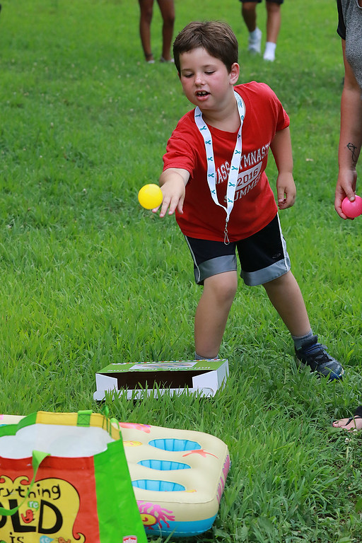 ". ""National Night Out\"" was held at Lowe Playground in Fitchburg on Tuesday night. Jack Decesare, 7, of Lunenburg plays one of the games at the event to try and win a prize. SENTINEL& ENTERPRISE/JOHN LOVE"