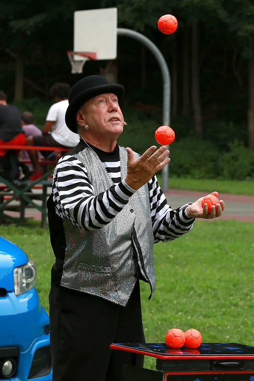 ". ""National Night Out\"" was held at Lowe Playground in Fitchburg on Tuesday night. Flippo from West Boylston does some juggling and magic to entertain the crowd at the event. SENTINEL& ENTERPRISE/JOHN LOVE"