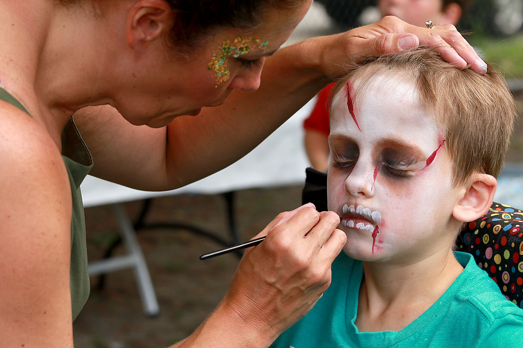 ". ""National Night Out\"" was held at Lowe Playground in Fitchburg on Tuesday night. William VanHazinga, 10, of Fitchburg gets his face painted like a zombie by Nicole Kirrane at the event. SENTINEL& ENTERPRISE/JOHN LOVE"