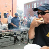 Sam Piccicuto enjoys a Hamburger cooked by the Leominster Fire Department at the City's National Night Out on Tuesday, August 3, 2021. SENTINEL & ENTERPRISE/JOHN LOVE