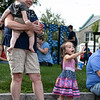 Enjoying the parade to open up Leominster's National Night Out on Tuesday, August 3, 2021 on Monument Square is Tammy Breen, Jameson Breen, 1, and Daylynn Garretson, 3, all from Leominster. SENTINEL & ENTERPRISE/JOHN LOVE