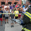 The Leominster Fire Department showed how they would rescue someone from a car when the doors won't open at the City's National Night Out on Tuesday, August 3, 2021. Crowds gathered to see the demonstration. SENTINEL & ENTERPRISE/JOHN LOVE
