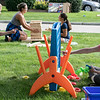Nick Orrell, 5, and his mom Kim enjoy a game of Connect Four at Leominster's National Night Out on Tuesday, August 3, 2021 held on and around Monument Square. SENTINEL & ENTERPRISE/JOHN LOVE