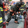 The Leominster Fire Department showed how they would rescue someone from a car when the doors won't open at the City's National Night Out on Tuesday, August 3, 2021. Using a spreader to get the door open is LT. Steve Provencher during the demonstration. SENTINEL & ENTERPRISE/JOHN LOVE