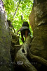 Cindy Climbing down into one of the Slot Canyons on the Devils Den Trail