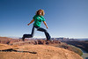 Jumping for Joy on the White Rim Trail in Canyonlands National Park, Utah - Photo by Pat Bonish
