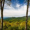 20th anniversary trip to Smokies & Pisgah Inn, May 14-22; Webb overlook, a few miles SE of Newfound Gap on US 441, elev 4775 ft (4744.5 where I stood, per GPS data), named for NC state Senator Charles Webb, strong backer of creating Great Smoky Mtns NP; stopped here both going to & returning from Cades Cove; overcast in evening, but interesting sky and beautiful views