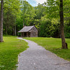 """20th anniversary trip to Smokies & Pisgah Inn, May 14-22; Cades Cove Historic District added to National Register of Historic Places 1977 (77000111), with with the 3 churches, Cable Mill, & various cabins & farms listed as contribution properties; drove 11-mi Cades Cove loop tour Monday, surprised by throngs of cars & people on weekday in mid-May, but ranger assured me crowd not atypical - traffic came to full stop at times, crept at 5-10 mph at others; many pull-offs parked full, so we stopped at few places; cabin of George Washington """"Carter"""" shields, stop 17; Shields wounded & crippled for life in April 1862 Battle of Shiloh, married & moved to Kansas after war, returned to Cades Cove 1906, bought this property 1910, moved away again 11 years later (don't know his age, but if only 14 when wounded, would have been 73 in 1921)"""