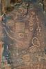 Multiple Hopi Petroglyphs carved into the sandstone - V Bar V Ranch, Arizona