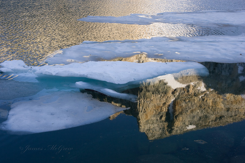 Reflections.  Copyright © 2008 James McGrew.   At nearly 11,000 ft elevation many tarns (lakes in the glacially carved bowls or cirques)  sometimes remain ice covered well into July.