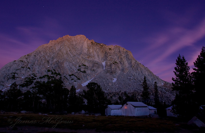 Alpenglow on Fletcher Peak from Vogelsang High Sierra Camp. This is not a sunset. True alpenglow occurs about 30-45 min after the sun has dropped below the horizon, and the sun's rays are scattered and refracted along the earth's atmosphere by high ice crystals or water vapor. This event happens more often in winter and only rarely occurs during the summer. When it does, the mountains or sky can begin to glow with a soft salmon pink, almost glowing from within just at the time the stars begin to appear in the sky.