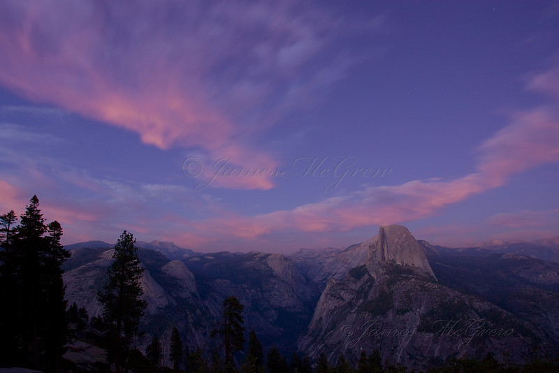 Twilight Cloud Dance over Half Dome.  ©2009, James McGrew  After the crowds faded away and photographers packed up their gear, I stopped painting and began photographing to create this image with clouds moving across the sky.