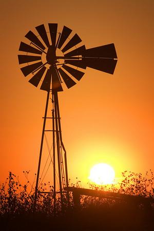 Windmill and an Oklahoma sunset