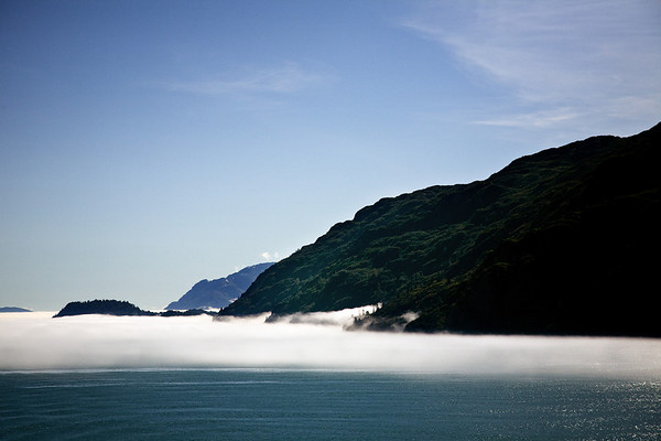 Low lying fog at the entrance to Glacier Bay National Park, Alaska from Icy Strait