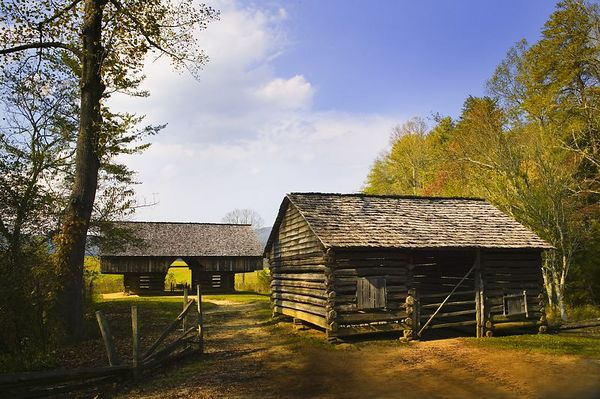 Cantilever Barn (background) and Corn Crib at the Tipton Place, Cades Cove, Great Smoky Mountains National Park.