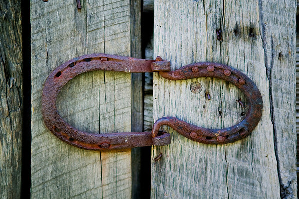 Horseshoe hinge on the door to the corn crib located at the Oconaluftee Mountain Farm Museum in the Great Smoky Mountains National Park