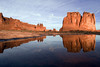 Morning at Courthouse Tower in Arches National Park.  Despite the appearance of this picture, the water is in a relatively tiny pool (3 to 4 feet across).  There is a large open area of sandstone with many depressions that gets filled with water after a rain.  Sunrise wasn't much since the clouds were still clearing but later on in the morning I was able to capture this image (while on a photo workshop with Jon Fuller).