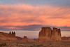 Sunrise over Courthouse Tower and Three Gossips, Arches National Park.