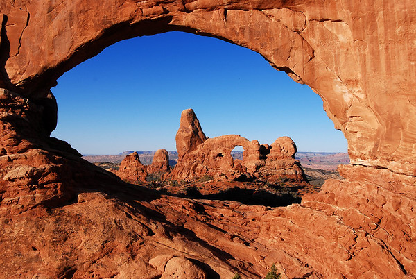 Turret Arch through North Window of Windows Archs in Arches National Park, Utah.