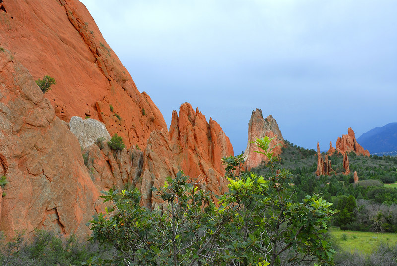 Garden of the Gods Colorado Landscape.<br /> <br /> <br /> <br /> The Rich reds in the rock were brought out by the full sunlight and dark passing storm.<br /> <br /> Daniel P Woods.