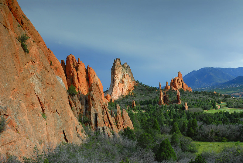 Garden of the Gods Colorado Landscape.<br /> <br /> The Rich reds in the rock were brought out by the full sunlight and dark passing storm.<br /> <br /> Daniel P Woods.