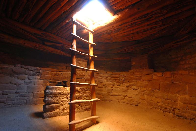 Mesa Verde Natl Park , CO<br /> Ladder and sunbeam entering a Kiva at Spruce Tree House.