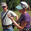 July 6, 2013.  Looking at a butterfly.  Friends of CSNM at Hobart Bluff.