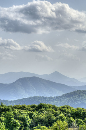 Faint mountain outlines cover the horizon, seen from the Beauty Spot on Unaka Mountain in Erwin, TN on Saturday, June 13, 2015. Copyright 2015 Jason Barnette  The Beauty Spot is located at Mile 350.5 on the Appalachian Trail in Tennessee.