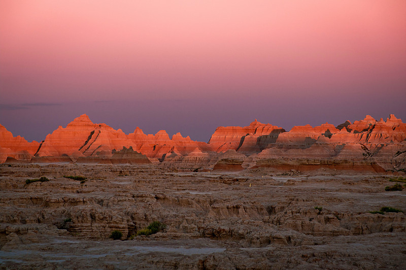 The sun begins to set over the Badlands.