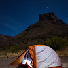 Sleeping under the stars and Casa Grande in Chisos Basin in Big Bend National Park.