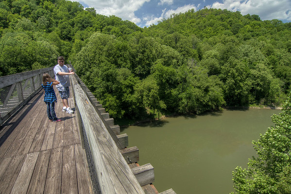 A family enjoys the view of the river from the top of the bridge at the Blue Heron Mining Camp in Stearns, KY on Monday, May 27, 2013. Copyright 2013 Jason Barnette  The Blue Heron Mining Camp is located about 10 miles outside Stearns. Also known as Mine 18, it was operated by the Stearns Coal and Lumber Company from 1937 - 1962.  Today the camp is open to the public and managed by the National Park Service as part of the Big South Fork National River and Recreation Area.