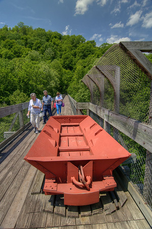 A group of visitors walk across the top of the bridge at the Blue Heron Mining Camp in Stearns, KY on Monday, May 27, 2013. Copyright 2013 Jason Barnette  The Blue Heron Mining Camp is located about 10 miles outside Stearns. Also known as Mine 18, it was operated by the Stearns Coal and Lumber Company from 1937 - 1962.  Today the camp is open to the public and managed by the National Park Service as part of the Big South Fork National River and Recreation Area.