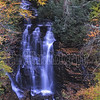 Soco Falls is a 35 foot waterfall located on the Cherokee Indian Reservation in Jackson County, North Carolina.  There are two falls here forming a single creek at their base.  The right side fall can be photographed from the observation deck, which is located about 100 yards from the parking lot.  To get to the base of the falls is trickier and requires some climbing.  Someone place a rope from the observation deck to the base when I was their on 10/13/2012.  However; I had taken a rope with me.  On a scale of 1 to 10 to rate its beauty I would rate it an 8.  Taken at 6:45AM, using a Nikon D600 and 24-70mm telephoto lens set at 45mm.  Aperture at f/4, Shutter 1.0 sec. and ISO 200.  Used a polarizer and tripod.