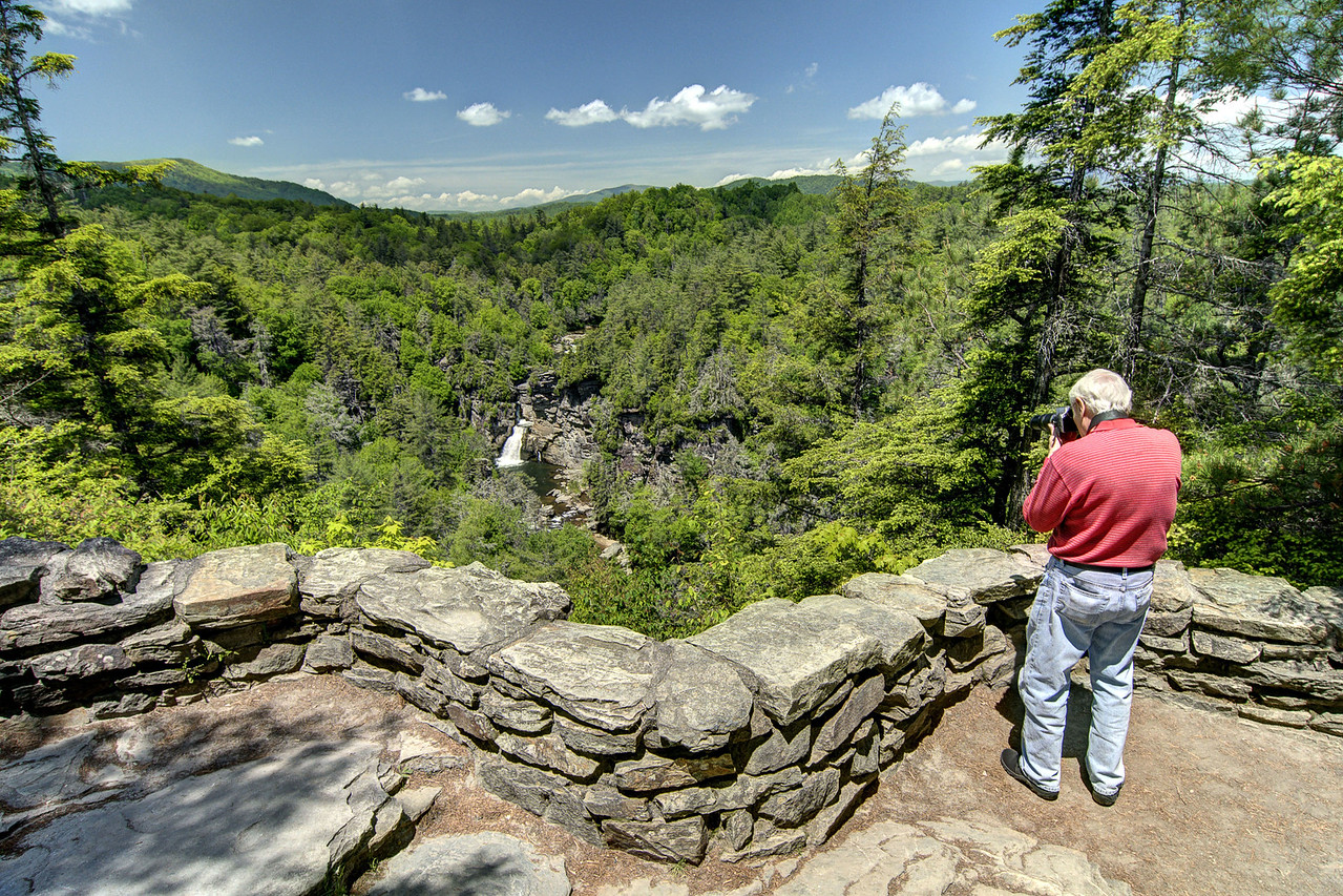 A man takes a photo of the distant waterfall at the Chimney View Overlook at Linville Falls at Milepost 316.3 on the Blue Ridge Parkway in NC on Wednesday, May 29, 2013. Copyright 2013 Jason Barnette