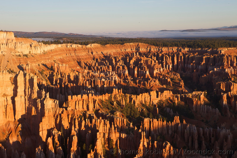 The hoodoos of Bryce Canyon light up at sunrise at Inspiration Point.