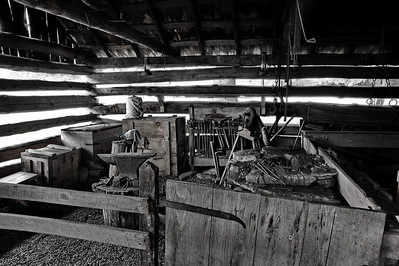 interior of theBlacksmith shop, Cable Mill Area   Camera: Nikon D3s, 24-85mm f2.8 lens, Moose Peterson Circular polarizing + warming filter, Gitzo tripod + Arca Swiss ball head; ISO at 200, Manual Exposure Mode, Manual Focus