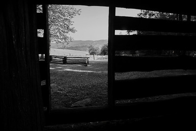 View out the door of a corn crib on the Tipton Place  Camera: Nikon D3s, 24-85mm f2.8 lens, Moose Peterson Circular polarizing + warming filter, Gitzo tripod + Arca Swiss ball head; ISO at 200, Manual Exposure Mode, Manual Focus