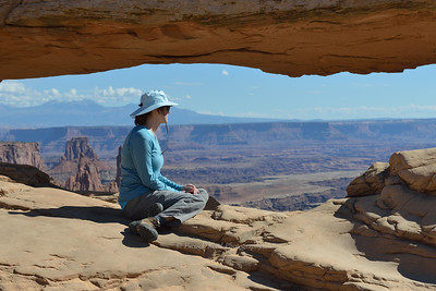 Lisa looking at the canyon below Mesa Arch