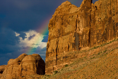 Rainbow forms over Gold Bar Canyon on the Colorado River after a summer storm, near Moab, Utah
