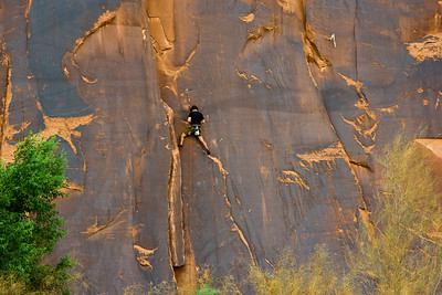 Rock Climber overlooking the Colorado River, near Moab, Utah