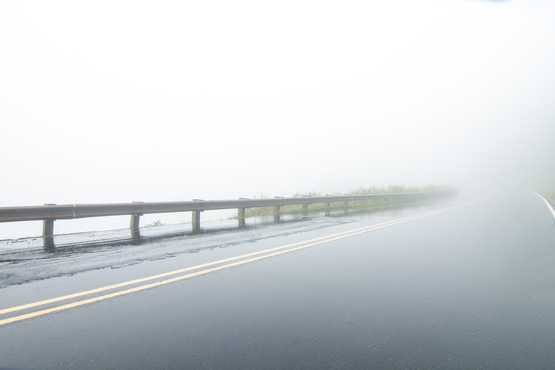 Heavy fog obscures the Cherohala Skyway in NC on Thursday, July 23, 2015. Copyright 2015 Jason Barnette  The Cherohala Skyway is a National Scenic Byway connecting the cities of Tellico Plains, Tennessee and Robbinsville, North Carolina. The 43-mile scenic highway features hiking trails, scenic overlooks, and natural vistas.