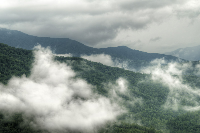 Clouds cling to the mountains along the Cherohala Skyway in NC on Thursday, July 23, 2015. Copyright 2015 Jason Barnette  The Cherohala Skyway is a National Scenic Byway connecting the cities of Tellico Plains, Tennessee and Robbinsville, North Carolina. The 43-mile scenic highway features hiking trails, scenic overlooks, and natural vistas.