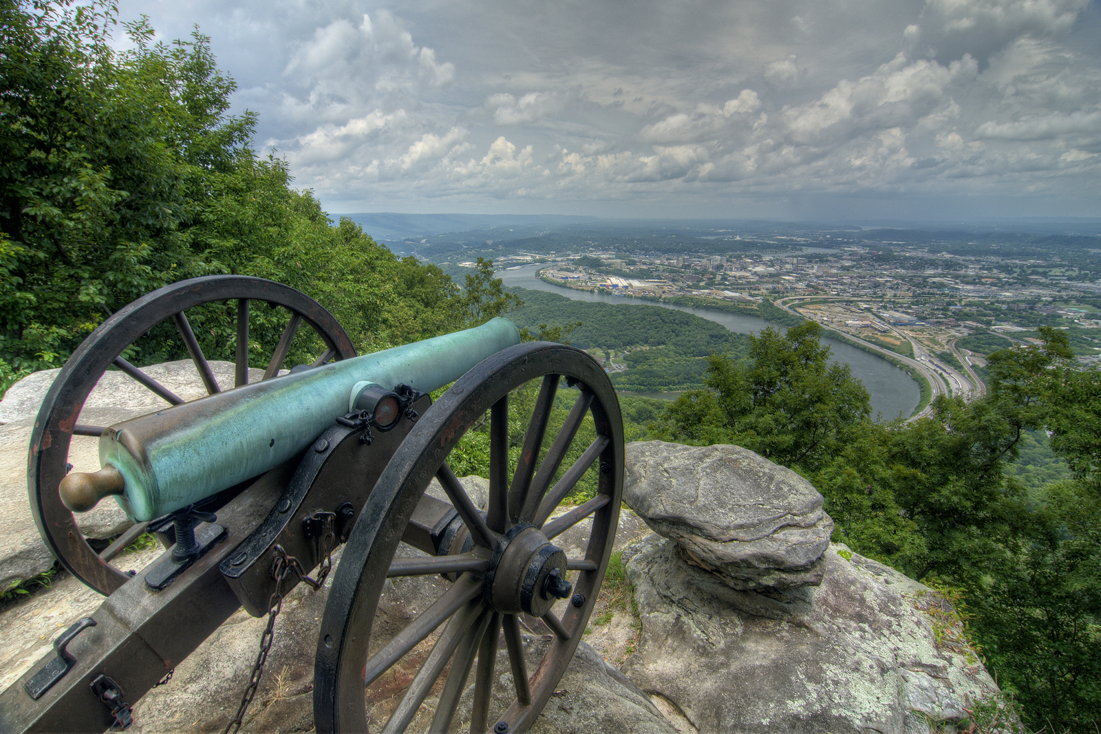 A Civil War-era canon overlooks the Tennessee River and downtown Chattanooga from Point Park, part of the Chickamauga & Chattanooga National Military Park, in Lookout Mountain, TN on Tuesday, July 21, 2015. Copyright 2015 Jason Barnette