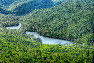 A lake far below the Pinnacle Overlook in Cumberland Gap National Historical Park in Middlesboro, KY on Tuesday, April 24, 2012. Copyright 2012 Jason Barnette
