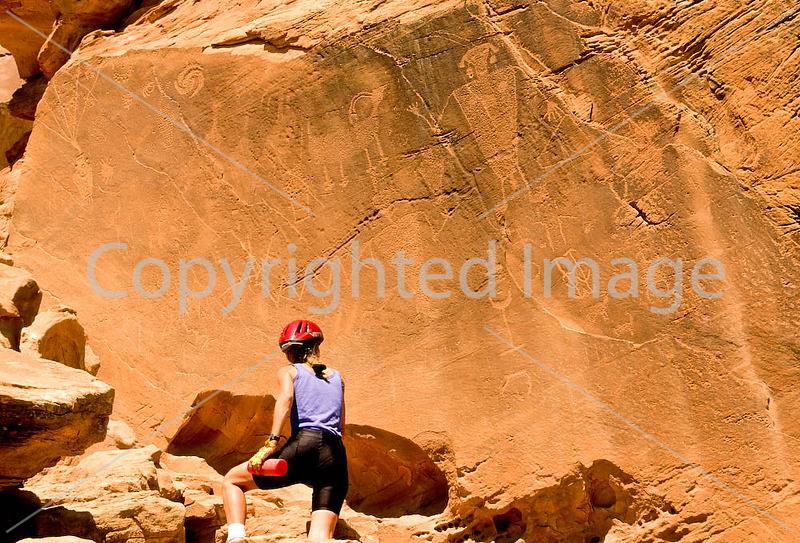 Mountain biker at petroglyph panel in Dinosaur National Monument 4