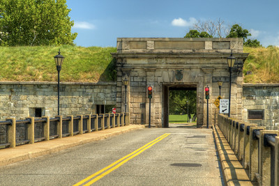 A bridge crossing the moat to a narrow, single-lane entrance into Fort Monroe National Monument in Hampton, VA on Wednesday, August 19, 2015. Copyright 2015 Jason Barnette  After proudly serving 188 years as a coastal fortification, in 2011 Fort Monroe opened as the newest national monument. Today the 325 acre fort is open to the public for exporation including the Casement Museum, streets, and a few buildings.