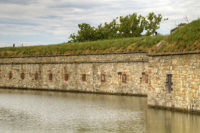 View from outside the moat at Fort Monroe National Monument in Hampton, VA on Wednesday, August 19, 2015. Copyright 2015 Jason Barnette  After proudly serving 188 years as a coastal fortification, in 2011 Fort Monroe opened as the newest national monument. Today the 325 acre fort is open to the public for exporation including the Casement Museum, streets, and a few buildings.