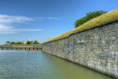 View on a pedestrian bridge crossing the moat at Fort Monroe National Monument in Hampton, VA on Wednesday, August 19, 2015. Copyright 2015 Jason Barnette  After proudly serving 188 years as a coastal fortification, in 2011 Fort Monroe opened as the newest national monument. Today the 325 acre fort is open to the public for exporation including the Casement Museum, streets, and a few buildings.