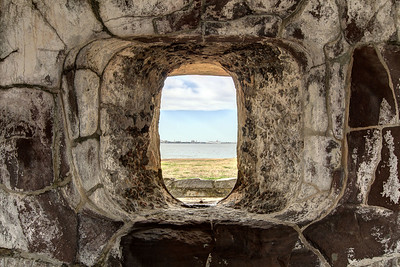 View through a porthole in the outer wall of Fort Sumter at the Fort Sumter National Monument in Charleston, SC on Wednesday, January 15, 2014. Copyright 2014 Jason Barnette  Construction began on Fort Sumter in 1829, but was still unfinished in 1861 when the Civil War began. On April 12, 1861 Confederate batteries opened fire on Fort Sumter, marking the first shots fired during the Civil War. Today Fort Sumter is part of the Fort Sumter National Monument which includes the fort, the Fort Sumter Education Center, and Fort Moultrie.