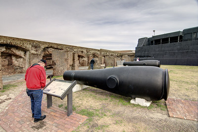A visitor reads information about a canon sitting inside Fort Sumter at the Fort Sumter National Monument in Charleston, SC on Wednesday, January 15, 2014. Copyright 2014 Jason Barnette  Construction began on Fort Sumter in 1829, but was still unfinished in 1861 when the Civil War began. On April 12, 1861 Confederate batteries opened fire on Fort Sumter, marking the first shots fired during the Civil War. Today Fort Sumter is part of the Fort Sumter National Monument which includes the fort, the Fort Sumter Education Center, and Fort Moultrie.